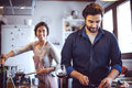Young couple cooking man and woman in their kitchen women Royalty Free Stock Image