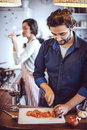Young couple cooking man and woman in their kitchen women Stock Photos