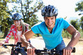 Young couple on country bike ride Royalty Free Stock Photo
