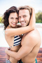 Young couple cuddling each other near pool portrait of on a sunny day Stock Photo