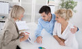 Young couple customers and adviser or agent talking about financ married sitting with an at desk in a guidance professional Stock Images