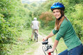Young Couple Cycling Along Country Track Royalty Free Stock Photo