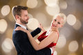Young Couple Dancing On Bokeh Background Royalty Free Stock Photo