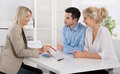Young couple in a date with a banker or adviser for retirement a have an appointment arrangements Stock Photo