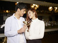 Young couple dating in bar asian enjoying a conversation Royalty Free Stock Photo