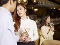 Young couple dating in bar asian having a conversation Stock Image