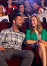 Young couple dating at cinema looking each other with love sitting in auditorium of smiling Royalty Free Stock Photo