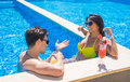 Young couple dating at the edge of the swimming pool Royalty Free Stock Photo