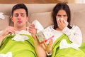 Young couple disease a during treatment at home Stock Image
