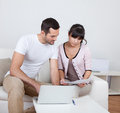 Young couple doing finances at laptop Stock Image