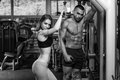 Young Couple Doing Heavy Weight Exercise For Triceps Royalty Free Stock Photo