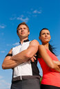 Young couple is doing sports outdoors Stock Photos