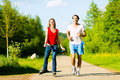 Young couple doing sports outdoors Royalty Free Stock Image