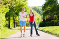 Young couple doing sports outdoors Royalty Free Stock Images