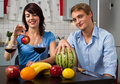 Young couple drink red wine and eat fruits Royalty Free Stock Photo