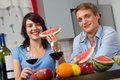 Young couple drink red wine and eat watermelon Stock Images