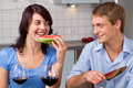 Young couple drink red wine and eat watermelon Royalty Free Stock Images