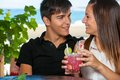 Young couple drinking cocktail on date close up portrait of sharing Stock Photos