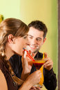 Young couple drinking cocktails in Stock Photography
