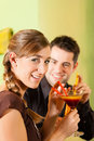Young couple drinking cocktails Stock Image