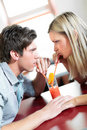 Young couple drinking one coctail Royalty Free Stock Photo