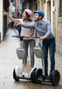 Young couple driving segways