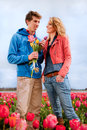 Young couple in Dutch flower fields Stock Image
