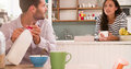 Young Couple Eating Breakfast In Kitchen Together Royalty Free Stock Photo