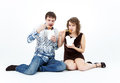 Young couple eating chinese food from lunch boxes with chopsticks Stock Photos