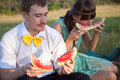 Young couple eating watermelon Royalty Free Stock Photography