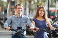 Young couple with electric bikes