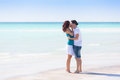Young couple embraced in a caribbean beach enjoying life Stock Image