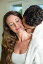 Young couple embracing in bathroom with eyes closed and smiling Stock Photos