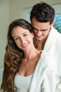 Young couple embracing in bathroom and smiling Royalty Free Stock Image