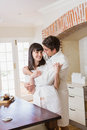 Young couple embracing each other romantic in kitchen Stock Photography
