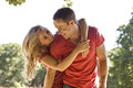 A young couple embracing, outdoors Royalty Free Stock Photo
