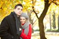 Young couple embracing in park in autumn Royalty Free Stock Photography