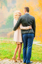 Young couple embracing in park Royalty Free Stock Photo