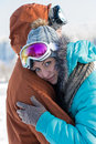 Young couple embracing winter countryside ski snow in goggles Royalty Free Stock Photography