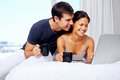 Young couple enjoy coffee relax home laptop love Stock Images