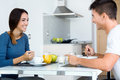 Young couple enjoying breakfast in the kitchen happy Royalty Free Stock Images
