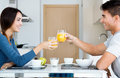 Young couple enjoying breakfast in the kitchen happy Royalty Free Stock Photos