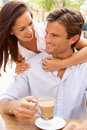 Young Couple Enjoying Coffee Stock Photography