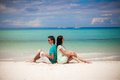 Young couple enjoying each other on sandy beach this image has attached release Stock Photos