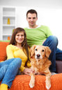 Young couple is enjoying in living room Royalty Free Stock Photo