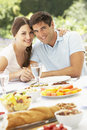 Young Couple Enjoying Meal Outdoors Royalty Free Stock Photo