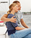 Young couple enjoying a sea voyage on a sailboat Royalty Free Stock Photography