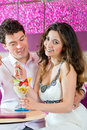 Young couple enjoying their time in ice cream parlor a cafe or eating an sundae together Stock Image