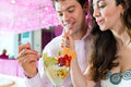 Young couple enjoying their time in ice cream parlor a cafe or eating an sundae together Stock Images