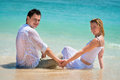 Young couple enjoying their vacation on beach Royalty Free Stock Images